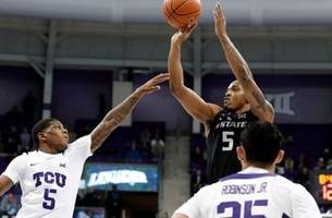 wildcats maintain tie for big 12 lead with 64-52 win at tcu