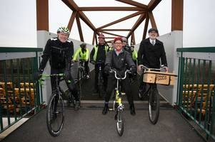 new foot and cycle bridge opens to connect boots site with university boulevard