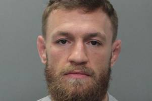 conor mcgregor arrested in miami for strong-arm robbery after 'smashing fan's phone'