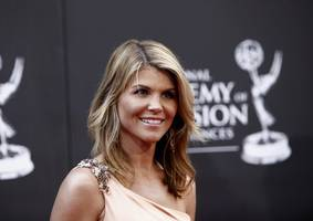 actress loughlin surrenders as admissions fallout spreads