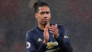 arsenal charged by fa after spectator confronted man utd's chris smalling
