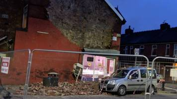 manchester house wall collapse injures boy, 2