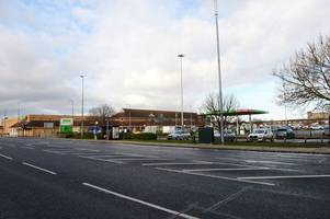 two teenagers in police custody after man 'threatened with knife' in asda car park