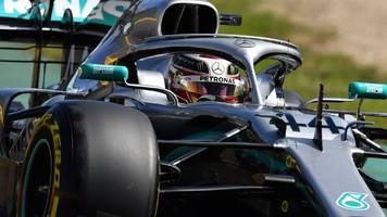 hamilton fastest in australia practice as ferrari hide pace