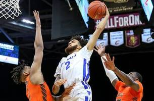 harris drops 31 and leads no. 18 buffalo past bowling green in mac championship