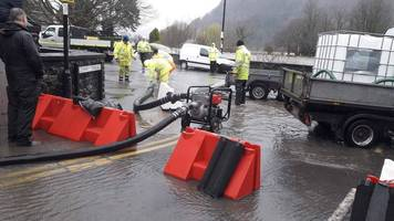 flood warnings in place as clean-up continues in north wales