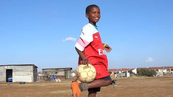 why arsenal's mesut ozil sent a kenyan boy football boots