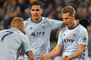 russell's late free kick goal helps sporting kc to 1-1 tie
