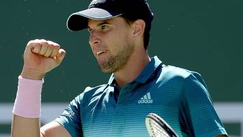 thiem comes from set down to beat federer at indian wells
