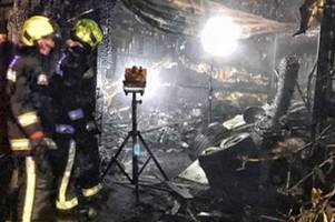 dramatic pictures show burnt out garage completely destroyed by fire