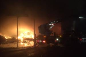 around 80 firefighters spend night tackling huge fire at mitcham waste centre