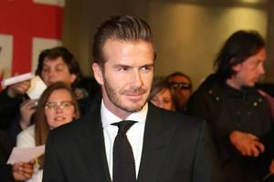 beckham to learn punishment for using phone while driving