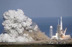 spacex's falcon heavy rocket may launch first commercial flight soon