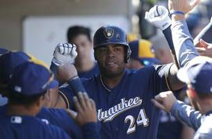 aguilar records 2 rbi in brewers' loss to rangers