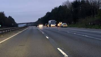 m11 traffic stopped due to 'bomb hoax' on coach near stansted