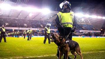 three everton fans held over millwall brawl