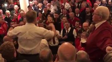 welsh rugby fans sing calon lân at the angel hotel