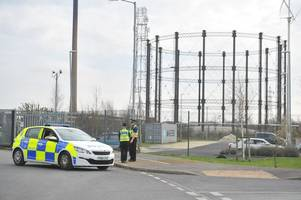 police warning as man scales metal structure off clough road