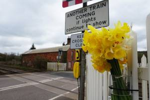 Flowers left by railway line where woman in her 50s was killed by train