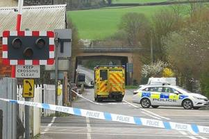 Flowers left for woman killed by train which blocked line from Taunton to Exeter