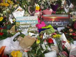 new zealanders united in grief: 'he is alone, everyone else is together'