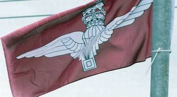 anger as parachute regiment flags flown in belfast