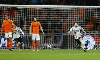 netherlands vs germany result: joachim low hails battling qualities after nico schulz's last-minute winner