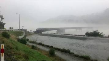 new zealand bridge washed away in heavy storm