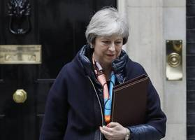 uk government defiant over may's brexit deal despite setback