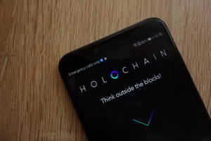 holo price drops to 28 satoshi as holders cash out in favor of bitcoin