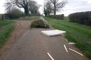 fly-tippers block whole road by dumping rubbish in middle of country lane