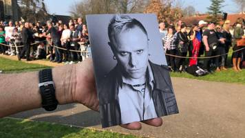 prodigy fans 'raise roof' at keith flint funeral