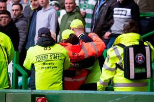 steward injured as celtic fans spill onto the pitch during rangers clash