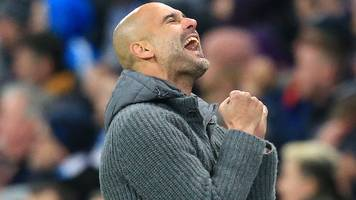 man city ease past cardiff to go top of premier league