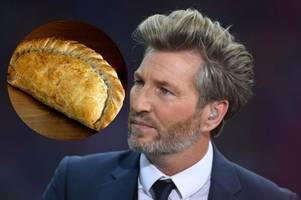 robbie savage spotted in devon and cornwall eating a pasty