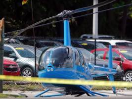 a helicopter crash-landed on a busy florida street, killing a man in a car on the ground