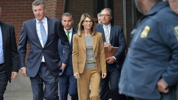 16 parents in college admissions scam charged with money laundering