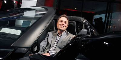 the latest wall street analyst to launch coverage of tesla says investors should compare it to an unlikely tech giant (tsla)