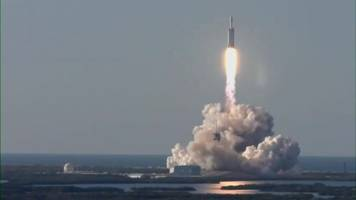 spacex falcon heavy launches its first commercial flight