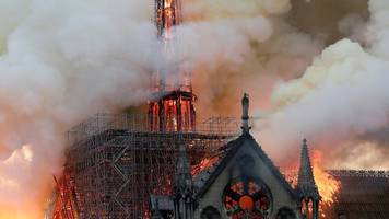 notre-dame fire: flames 'have completely engulfed the roof'