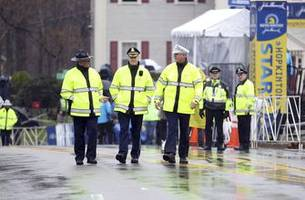 The Latest: Wheelchair race is off at wet Boston Marathon