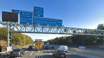 m25 closed after man dies in lorry and truck crash
