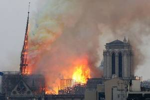 notre dame fire in heartbreaking pictures as paris mourns iconic landmark