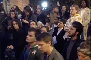 haunting moment people unite to sing 'ave maria' as notre dame engulfed by fire