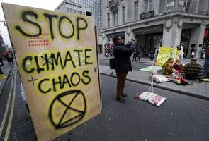 climate change activists occupy international criminal court in the hague