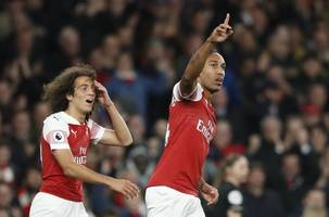 premier league: aubameyang's crazy goal helps arsenal win 1-0 vs 10-man watford