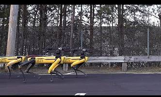 Watch a team of Boston Dynamics robots pull a truck like champs