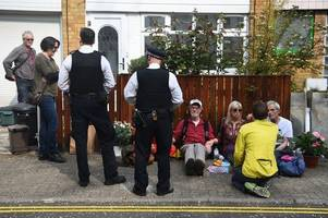 Extinction Rebellion ecowarriors glue themselves to fence outside Jeremy Corbyn's home