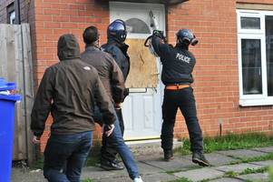 monkey dust raids see police smash way into house using chainsaw