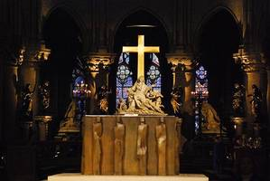 the 'miracle' of notre dame: altar cross becomes symbol of hope for france after devastating fire